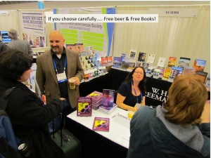 Stephanie J Slater doing an author signing in a vendor booth